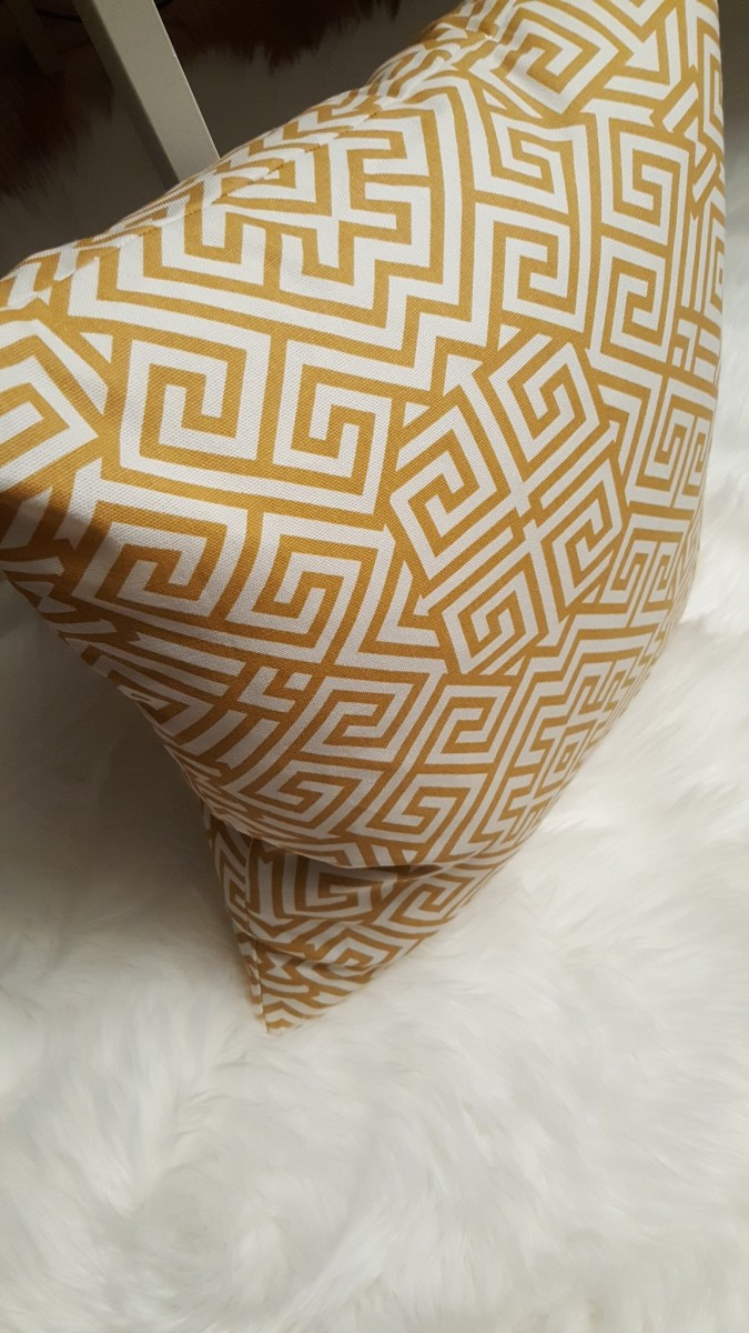 yellow geometric pillow